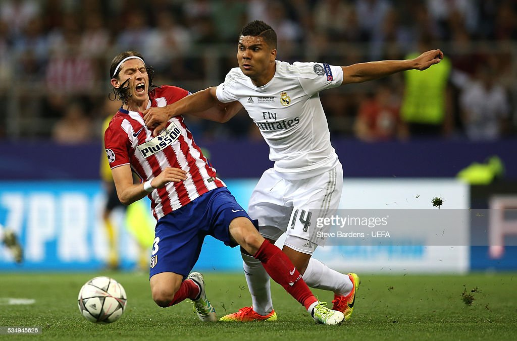Felipe Luis of Atletico Madrid and <a gi-track='captionPersonalityLinkClicked' href=/galleries/search?phrase=Casemiro&family=editorial&specificpeople=7150894 ng-click='$event.stopPropagation()'>Casemiro</a> of Real Madrid compete for the ball during the UEFA Champions League Final between Real Madrid and Club Atletico de Madrid at Stadio Giuseppe Meazza on May 28, 2016 in Milan, Italy..