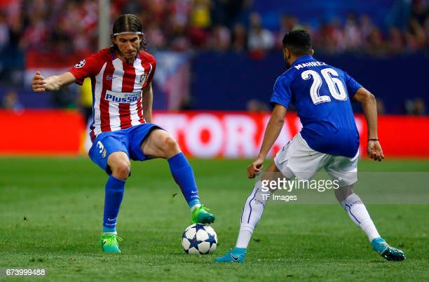 Filipe Luis of Atletico Madrid and Riyad Mahrez of Leicester City battle for the ball during the UEFA Champions League Quarter Final first leg match...
