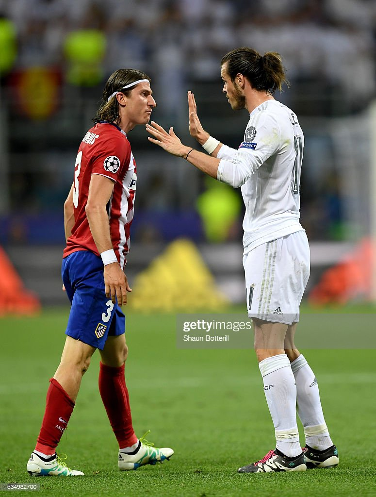 <a gi-track='captionPersonalityLinkClicked' href=/galleries/search?phrase=Filipe+Luis&family=editorial&specificpeople=3941966 ng-click='$event.stopPropagation()'>Filipe Luis</a> of Atletico Madrid argues with <a gi-track='captionPersonalityLinkClicked' href=/galleries/search?phrase=Gareth+Bale&family=editorial&specificpeople=609290 ng-click='$event.stopPropagation()'>Gareth Bale</a> of Real Madrid during the UEFA Champions League Final match between Real Madrid and Club Atletico de Madrid at Stadio Giuseppe Meazza on May 28, 2016 in Milan, Italy.
