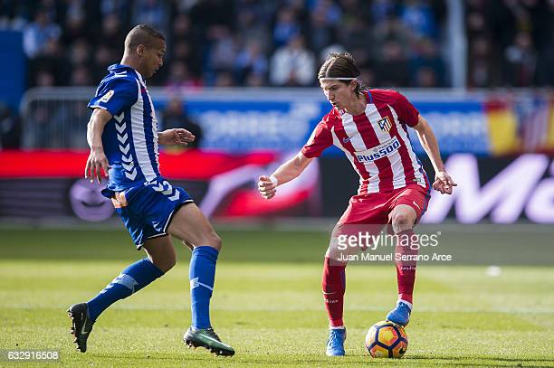 Filipe Luis of Atletico Madrid duels for the ball with Deyverson Brum of Deportivo Alaves during the La Liga match between Deportivo Alaves and...