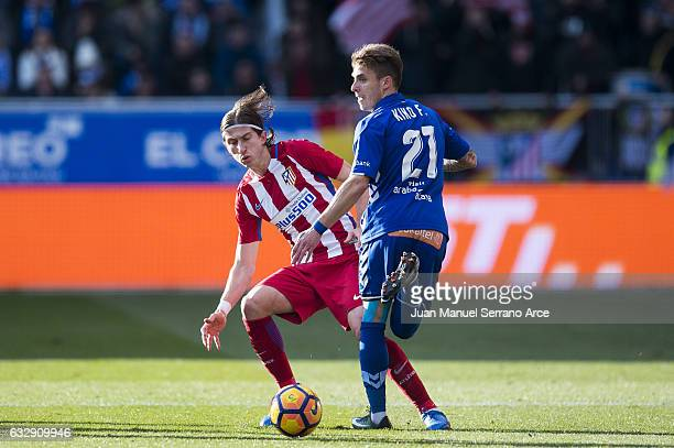 Filipe Luis of Atletico Madrid duels for the ball with Francisco Femenia of Deportivo Alaves during the La Liga match between Deportivo Alaves and...