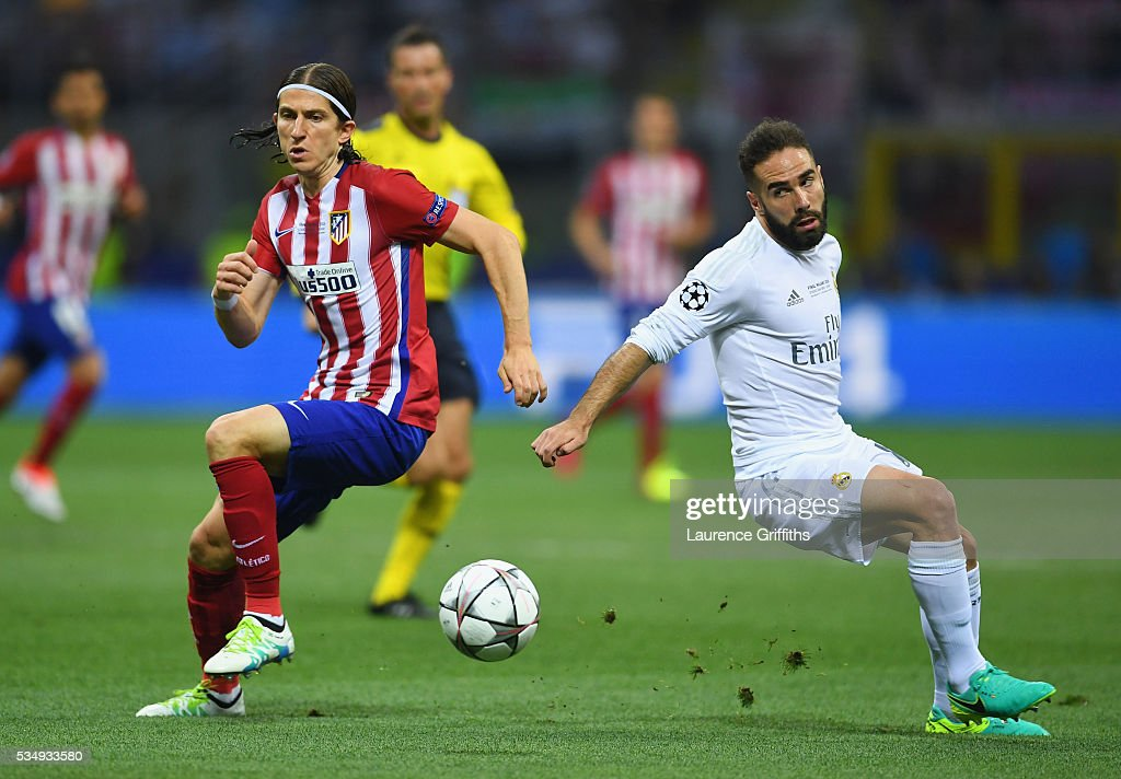 Filipe Luis of Atletico Madrid gets away from Dani Carvajal of Real Madrid during the UEFA Champions League Final match between Real Madrid and Club Atletico de Madrid at Stadio Giuseppe Meazza on May 28, 2016 in Milan, Italy.