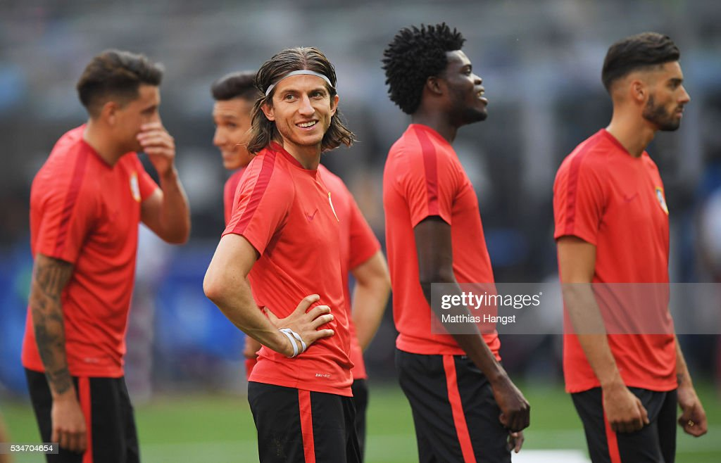 Filipe Luis of Atletico Madrid looks on during an Atletico de Madrid training session on the eve of the UEFA Champions League Final against Real Madrid at Stadio Giuseppe Meazza on May 27, 2016 in Milan, Italy.
