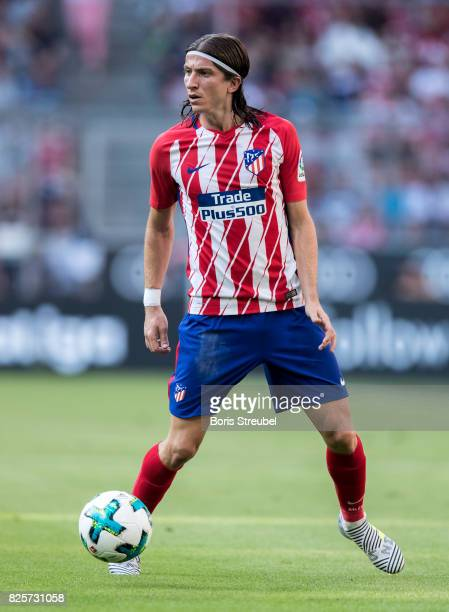 Filipe Luis of Atletico Madrid runs with the ball during the Audi Cup 2017 match between Club Atletico de Madrid and SSC Napoli at Allianz Arena on...
