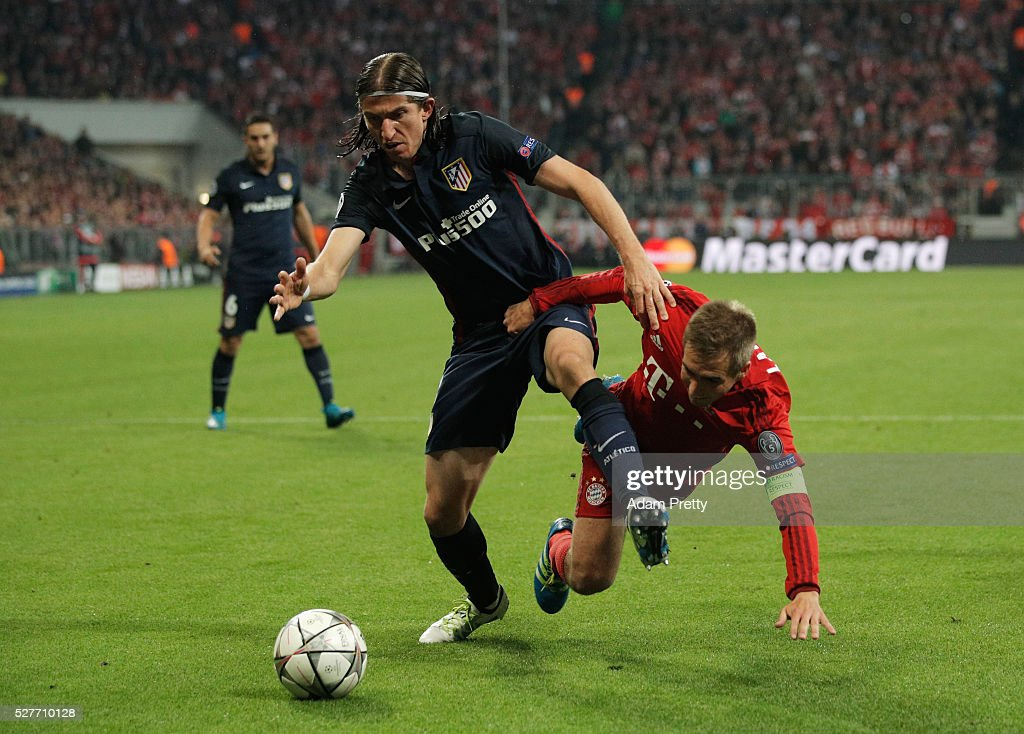 Felipe Luis of Atletico Madrid tussles with Philipp Lahm of Bayern Munich during UEFA Champions League semi final second leg match between FC Bayern Muenchen and Club Atletico de Madrid at Allianz Arena on May 3, 2016 in Munich, Germany.