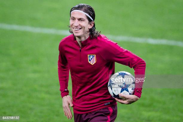 Filipe Luis of Atletico smiles during the training prior the UEFA Champions League Round of 16 first leg match between Bayer Leverkusen and Club...