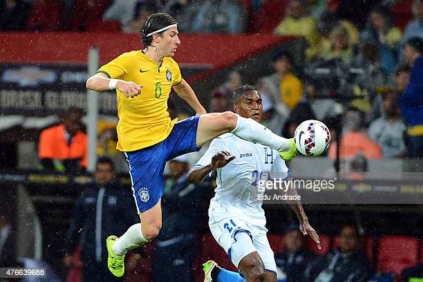 Filipe Luis of Brazil competes for the ball with Brayan Beckeles of Honduras during the international friendly match between Brazil and Honduras at...