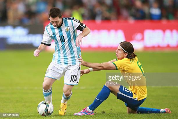 Filipe Luis of Brazil competes the ball with Lionel Messi of Argentina during Super Clasico de las Americas between Argentina and Brazil at Beijing...