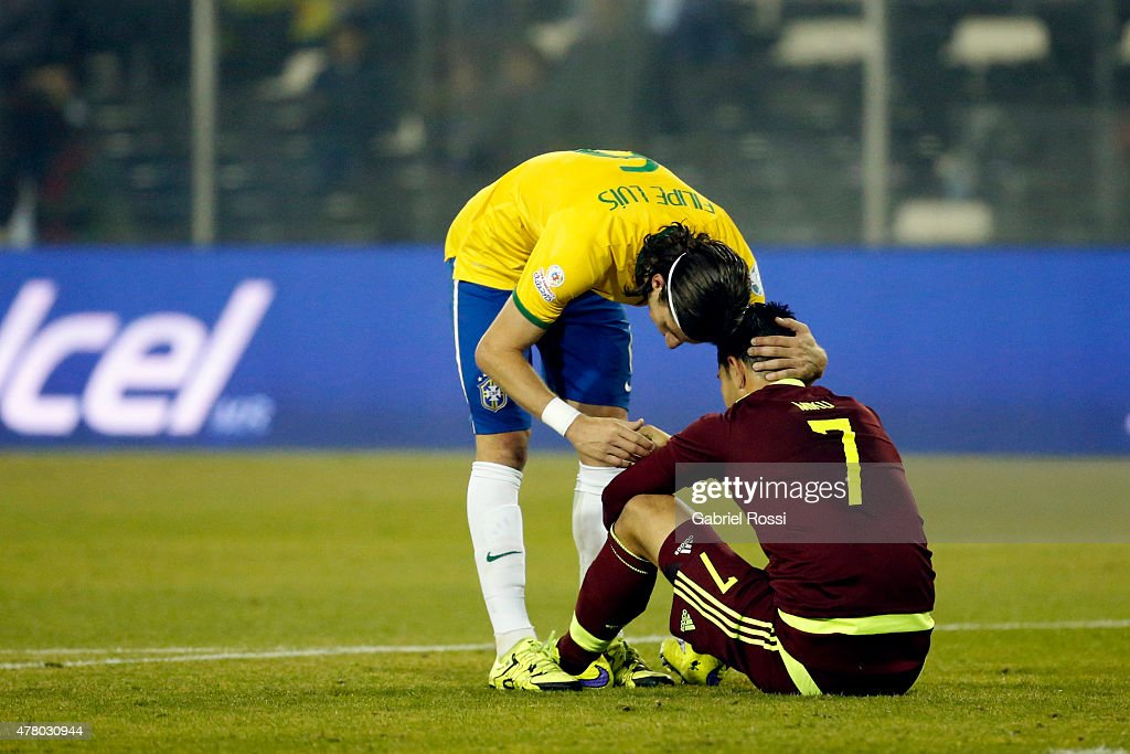 Filipe Luis of Brazil hugs Nicolas Fedor of Venezuela after the 2015 Copa America Chile Group C match between Brazil and Venezuela at Monumental David Arellano Stadium on June 21, 2015 in Santiago, Chile.