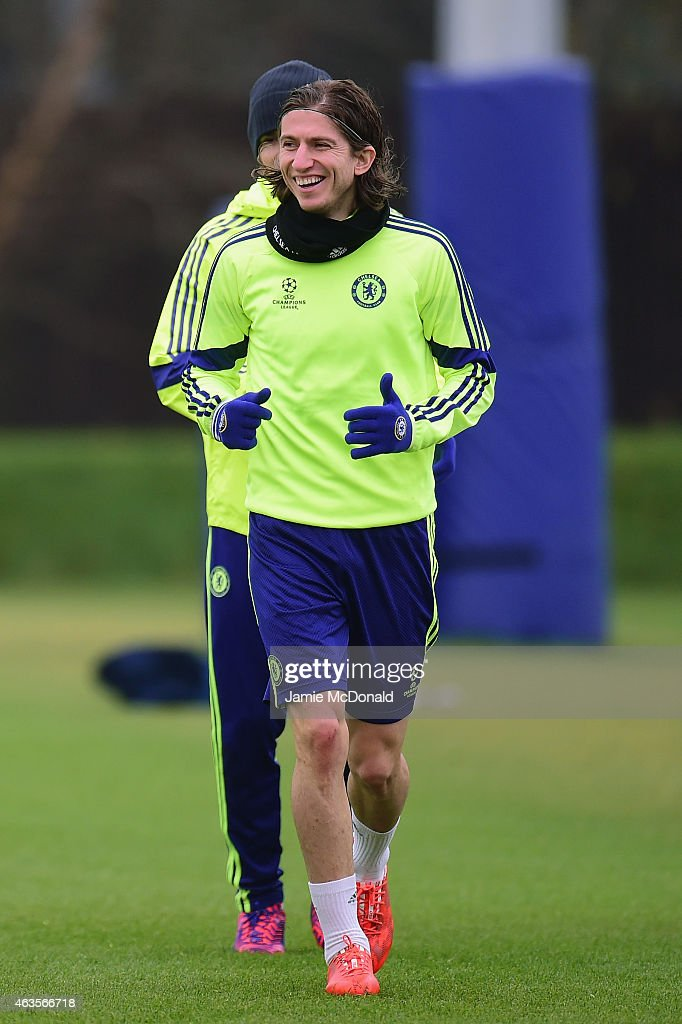 <a gi-track='captionPersonalityLinkClicked' href=/galleries/search?phrase=Filipe+Luis&family=editorial&specificpeople=3941966 ng-click='$event.stopPropagation()'>Filipe Luis</a> of Chelsea smiles during a Chelsea training session ahead of the UEFA Champions League round of 16 match against Paris Saint-Germain at Cobham Training Centre on February 16, 2015 in London, United Kingdom.