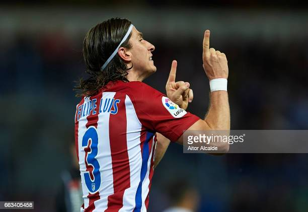 Filipe Luis of Club Atletico de Madrid celebrates after scoring the fsecond goal for Club Atletico de Madrid during La Liga match between Malaga CF...
