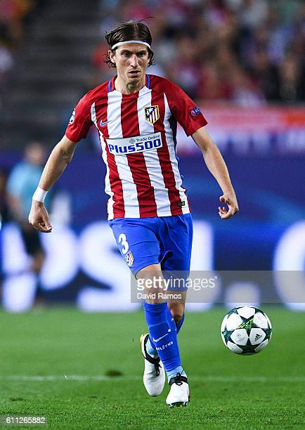 Filipe Luis of Club Atletico de Madrid runs with the ball during the UEFA Champions League Group D match between Club Atletico de Madrid and FC...