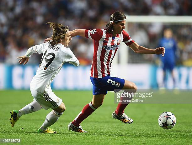 Filipe Luis of Club Atletico de Madrid takes on Luka Modric of Real Madrid during the UEFA Champions League Final between Real Madrid and Atletico de...