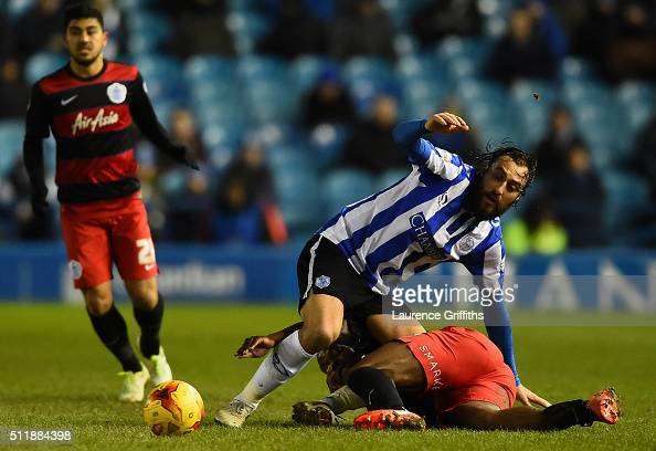 Filipe Melo of Sheffield Wednesday battles with Nedum Onuoha of Queens Park Rangers during the Sky Bet Championship match between Sheffield Wednesday...