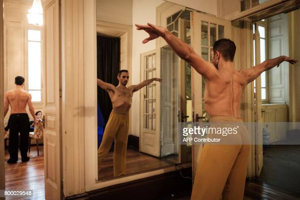 Filipe Moreira principal dancer at the Rio de Janeiro ballet warms up in front of the mirror before the last rehearsal of Carl Orff's 'Carmina...