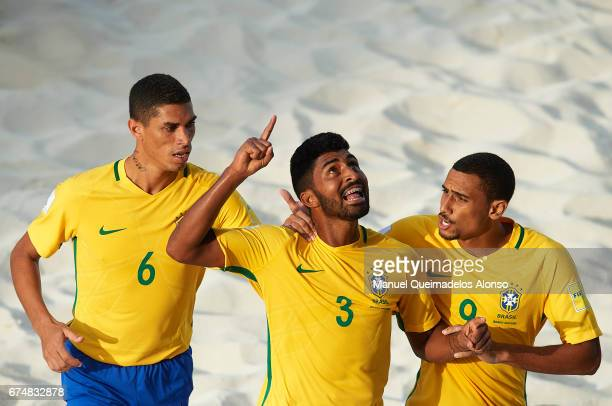 Filipe of Brazil celebrates scoring his team's first goal with his teammates Rodrigo da Costa and Lucao during the FIFA Beach Soccer World Cup...