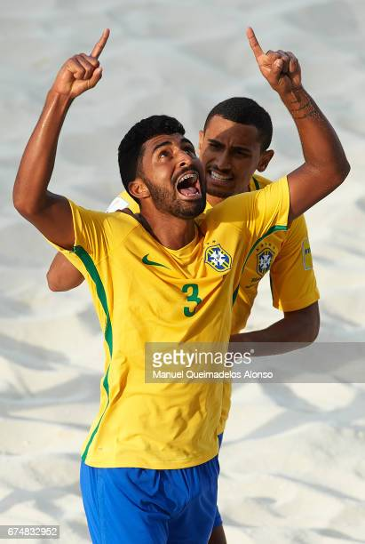 Filipe of Brazil celebrates scoring his team's first goal with his teammate Rodrigo da Costa during the FIFA Beach Soccer World Cup Bahamas 2017...