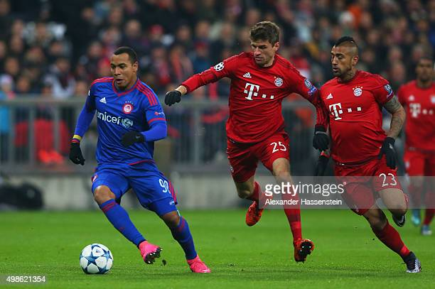 Filipe Pardo of Olympiacos goes past Thomas Mueller and Arturo Vidal of Bayern Muenchen during the UEFA Champions League group F match between FC...