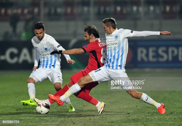Filipe Teixeira of Astra Giurgiu vies for the ball with Timoty Castagne of KRC Genk during the UEFA Europa League round of 32 firstleg football match...