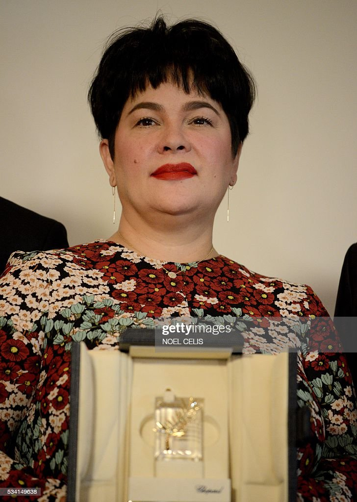 Filipina actress Jaclyn Jose, winner of Palme d'Or for best actress, poses for a picture during a press conference in Manila on May 25, 2016. The Philippines' entertainment industry celebrated Jose's surprise win at the Cannes film festival, hailing her as one of the nation's hardest working and most versatile actresses who deserves global acclaim. / AFP / NOEL
