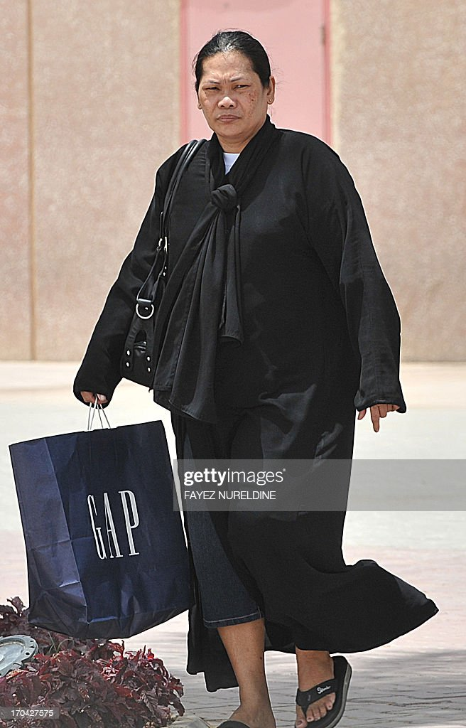 A Filipina maid carries a shopping bag as she walks out of a mall in Riyadh, on June 12, 2013. A three-month reprieve ended for Fhilipino death row convict Joselito Zapanta, who risks execution in Saudi Arabia for having failed to raise nearly $1 million in 'blood money' to pay the kin of his murdered landlord.