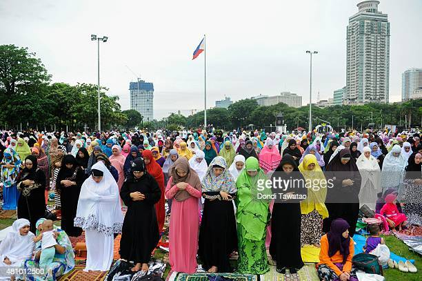 Filipina Muslims pray as they ended Ramadan on July 17 2015 in Manila Philippines Muslims in the Philippines join their brothers and sisters around...