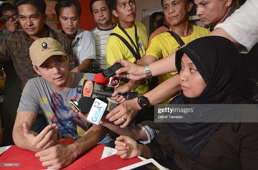 Filipino action star and Muslim convert Robin Padilla (L) and Jacel Kiram, daughter of self-proclaimed Sulu Sultan Jamalul Kiram III, speak to reporters in a press conference at the Kiram residence on March 2, 2013 in Manila, Philippines. President Benigno Aquino III has urged followers of Jamalul Kiram III to surrender and come out of hiding in the village of Lahad Datu, Sabah. Malaysian Prime Minister Najib Razak has warned he will take action against the group, which were involved in a shoot-out with Malaysian police that killed two Malaysian police commandos and left 12 followers of Kiram dead. (Photo by Dondi Tawatao/Getty