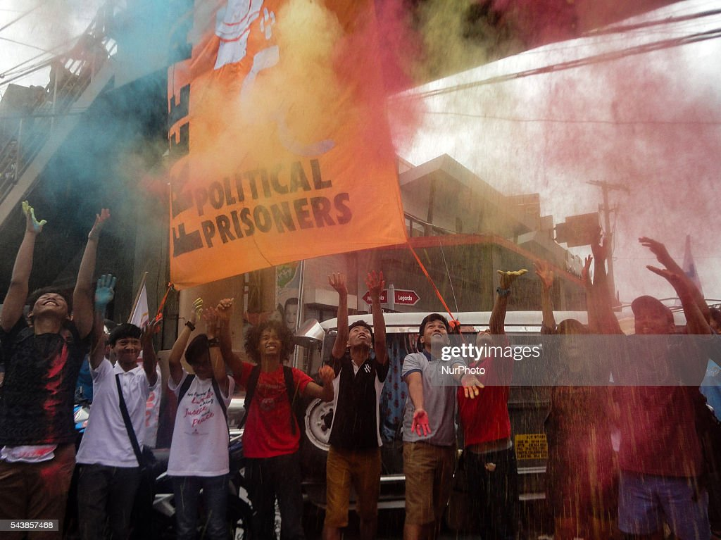 Filipino activists throw colored powder to celebrate the inauguration of Philippine President Rodrigo Duterte, during a rally on the president's inauguration on Thursday, 30 June 2016, in Manila, Philippines.