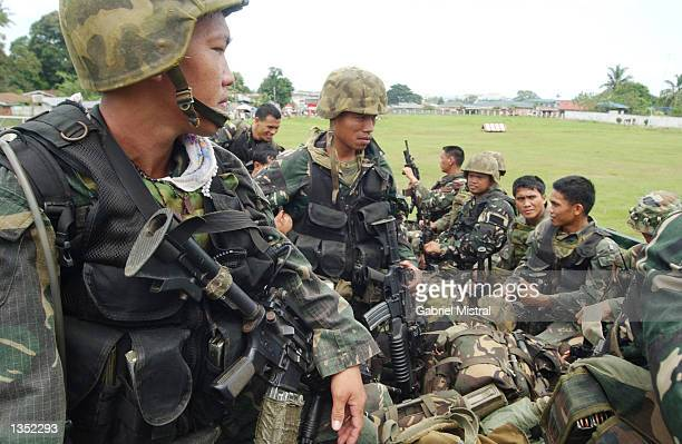 Filipino army soldiers part of Light Reaction Company who were trained by US soldiers during a US Philippine war exercise prepare for an exercise...