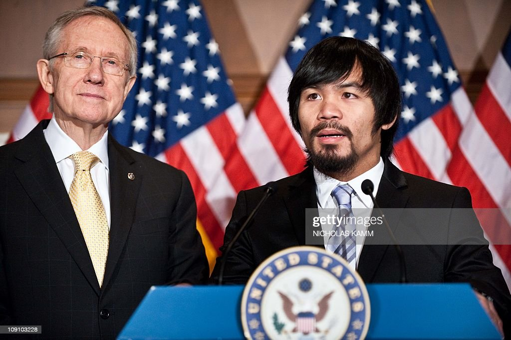 Filipino boxer and congressman Manny Pacquiao speaks to the press with US Senate Majority Leader Harry Reid at the Capitol in WashingtonDC on...