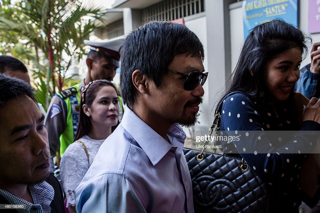 Filipino boxing icon <a gi-track='captionPersonalityLinkClicked' href=/galleries/search?phrase=Manny+Pacquiao&family=editorial&specificpeople=3855506 ng-click='$event.stopPropagation()'>Manny Pacquiao</a> (C), arrives at Wirogunan prison to meet convicted drug trafficker Mary Jane Veloso of the Philippines on July 10, 2015 in Yogyakarta, Indonesia. Veloso was sentenced to death after being arrested in Adisucipto International Airport in Yogyakarta with 2.6kg of heroin. Pacquiao will meet with Indonesian President Joko Widodo in support of Veloso, who maintains her innocence.