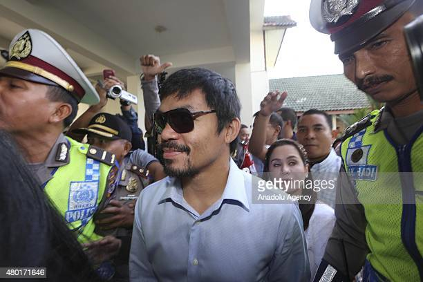 Filipino boxing icon Manny Pacquiao arrives to meet convicted drug trafficker Mary Jane Veloso of the Philippines during a visit at Wirogunan prison...