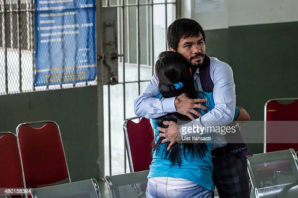 Filipino boxing icon Manny Pacquiao hugs convicted drug trafficker Mary Jane Veloso of the Philippines during a visit at Wirogunan prison on July 10...