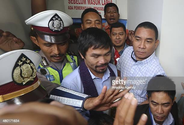 Filipino boxing icon Manny Pacquiao meets convicted drug trafficker Mary Jane Veloso of the Philippines during a visit at Wirogunan prison on July 10...