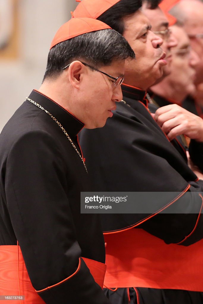 Filipino cardinal Luis Antonio Tagle (L) attends a meeting of prayer at St. Peter's Basilica on March 6, 2013 in Vatican City, Vatican. The start-date of the conclave to elect a new Pope, following the resignation of Pope Benedict XVI, has yet to be confirmed as many cardinals have sought more time to discuss the issues currently facing the Catholic church.
