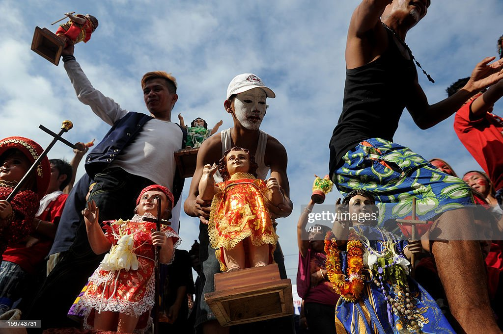 Filipino catholic devotees display statues of the infant Jesus during the annual festival of Santo Nino at the Santo Nino Church in Manila on January 20, 2013. Hundreds of Filipino devotees joined the religious festival. AFP PHOTO/NOEL CELIS