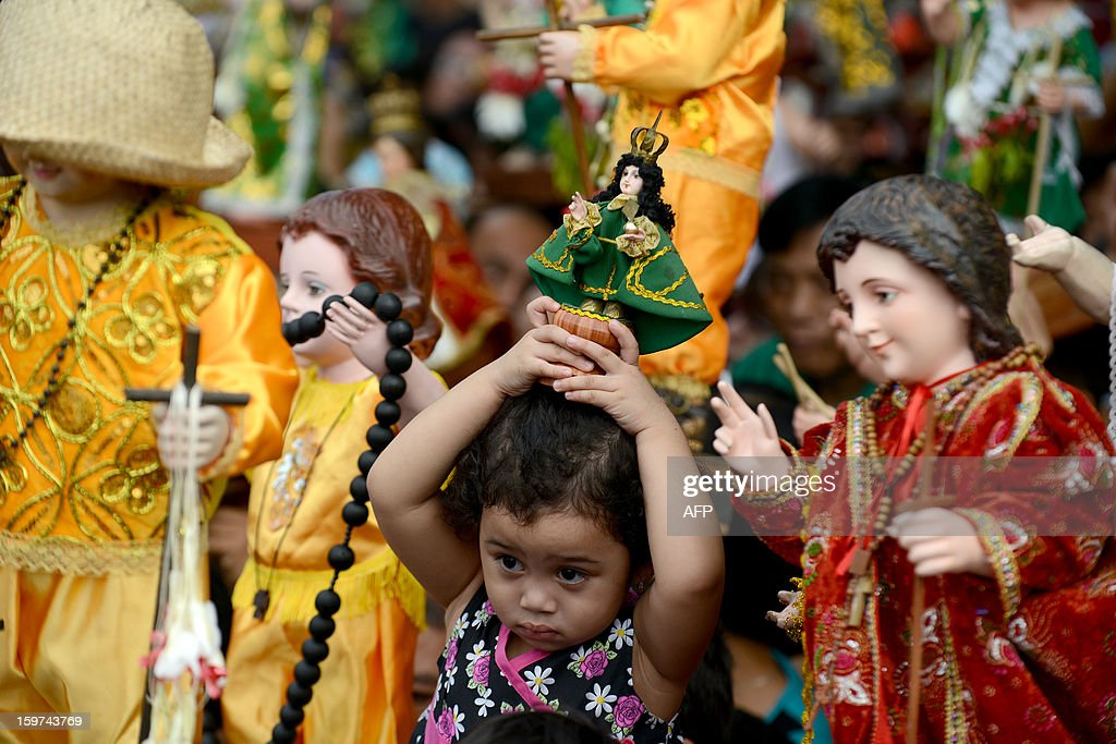 Filipino catholic devotees display statues of the infant Jesus during the annual festival of Santo Nino at the Santo Nino Church in Manila on January 20, 2013. Hundreds of Filipino devotees joined the religious festival.
