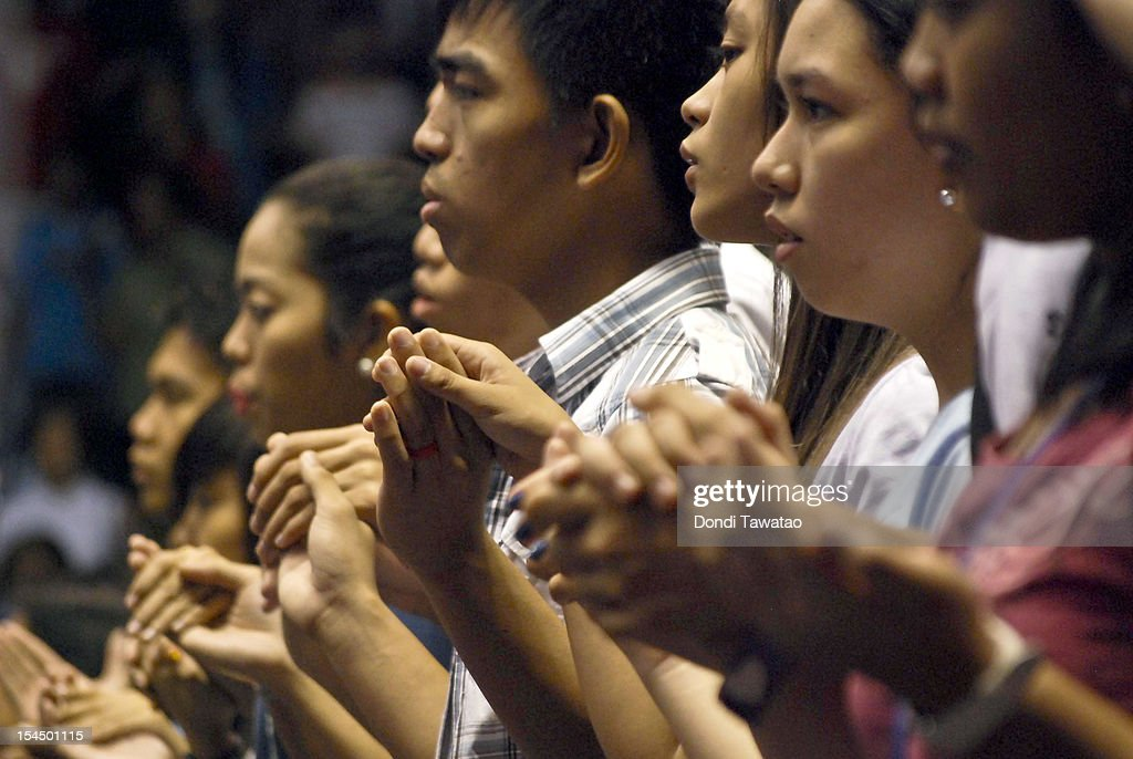 Filipino Catholics hold hand in prayer during a mass for St Pedro Calungsod, the Philippines' second saint on October 21, 2012 in Manila, Philippines. Millions across the Philippines celebrated the canonization of the 17-year-old Filipino missionary, who was killed 340 years ago while trying to convert locals on the Pacific island of Guam. The Philippines is the only country in Southeast Asia with a predominantly Catholic majority, with around 80 percent practicing the faith.