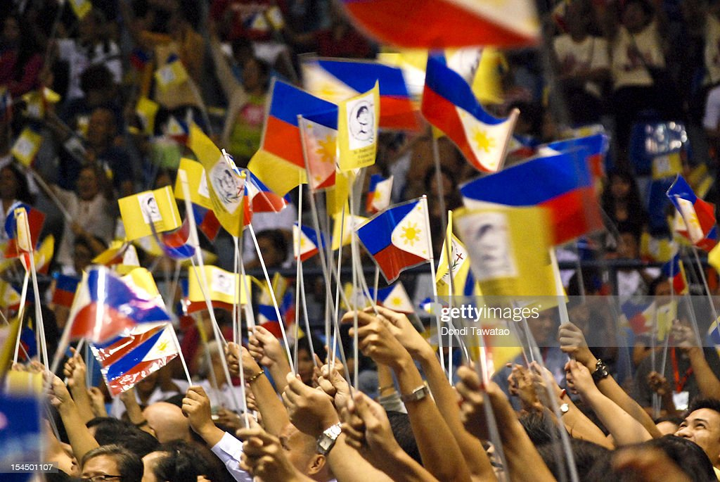 Filipino Catholics wave Philippine flags with images of St Pedro Calungsod, the Philippines' second saint during mass on October 21, 2012 in Manila, Philippines. Millions across the Philippines celebrated the canonization of the 17-year-old Filipino missionary, who was killed 340 years ago while trying to convert locals on the Pacific island of Guam. The Philippines is the only country in Southeast Asia with a predominantly Catholic majority, with around 80 percent practicing the faith.