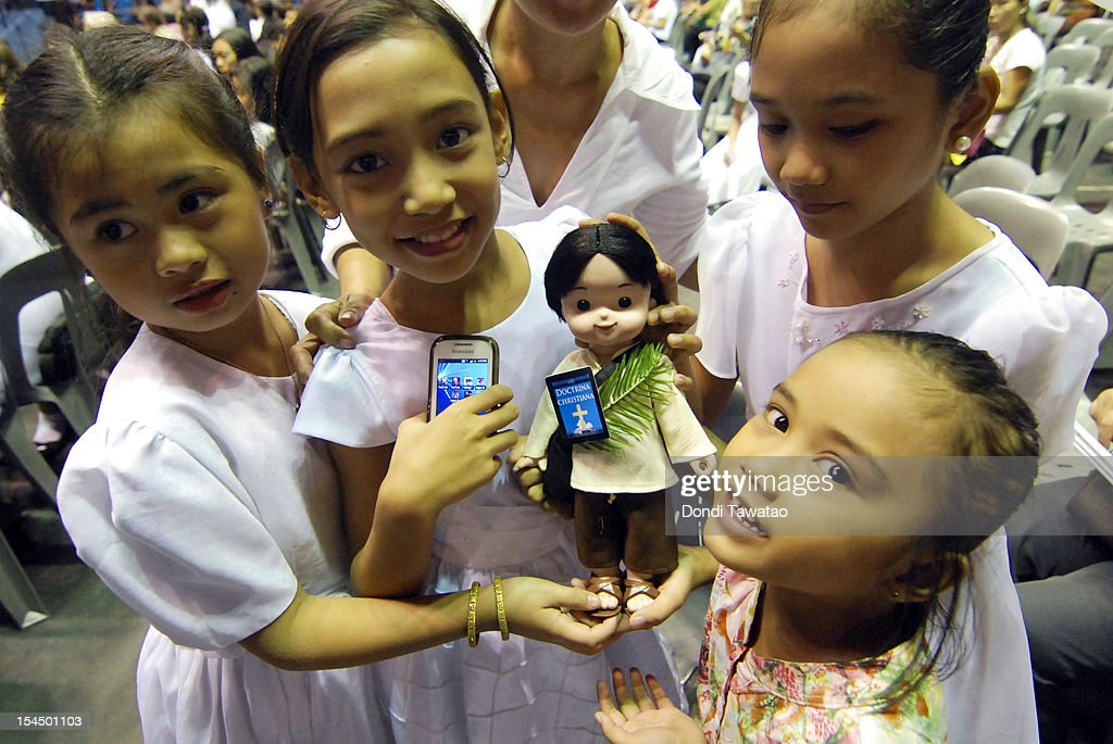 Filipino children display a doll of St Pedro Calungsod, the Philippines' second saint during mass on October 21, 2012 in Manila, Philippines. Millions across the Philippines celebrated the canonization of the 17-year-old Filipino missionary, who was killed 340 years ago while trying to convert locals on the Pacific island of Guam. The Philippines is the only country in Southeast Asia with a predominantly Catholic majority, with around 80 percent practicing the faith.