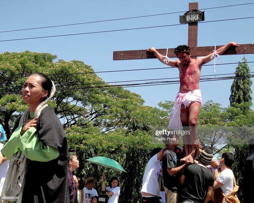 filipino devotees reenact the crucifixion of jesus christ