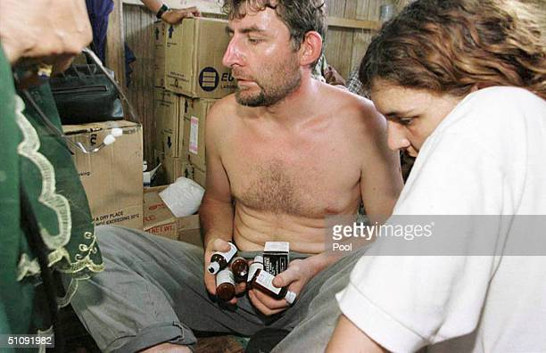 Filipino Doctor Not Visible In Picture Gives French Couple Stephane Loisy Center And Sonya Wending Medicine In A Shack On Jolo Island In The Southern...