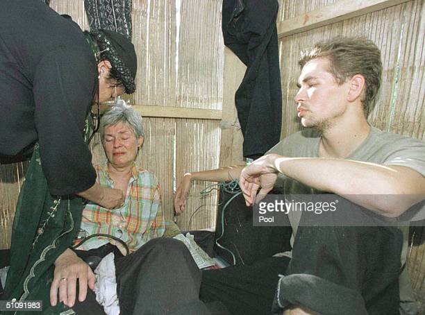 Filipino Doctor Treats German Hostage Renate Juta Center While Her Son Marc Walleri Sits At Her Right May 1 2000 Inside A Hut On Jolo Island...