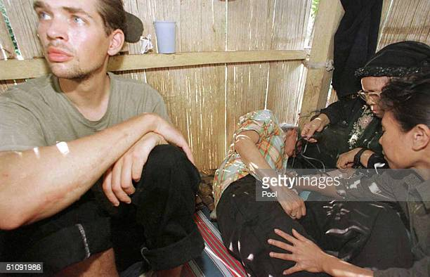 Filipino Doctor Treats German Hostage Renate Juta Center While Her Son Marc Walleri Sits At Her Left May 1 2000 Inside A Hut On Jolo Island...