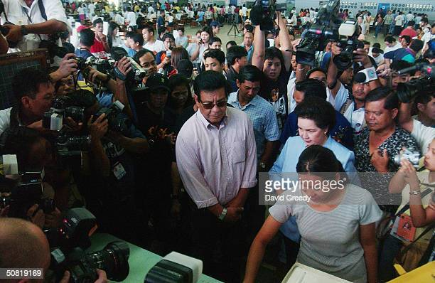 Filipino film icon and Presidential hopeful Fernando Poe Jr awaits his turn at the ballot box on May 10 2004 in his home district of San Juan in...
