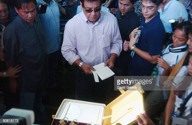 Filipino film icon and Presidential hopeful Fernando Poe Jr approaches the ballot box on May 10 2004 in his home district of San Juan in Manila...