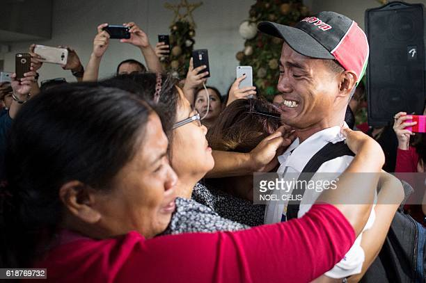 Filipino fisherman Arnel Balbero who was held hostage for nearly five years by Somali pirates cries as he meets his relatives after arriving at...