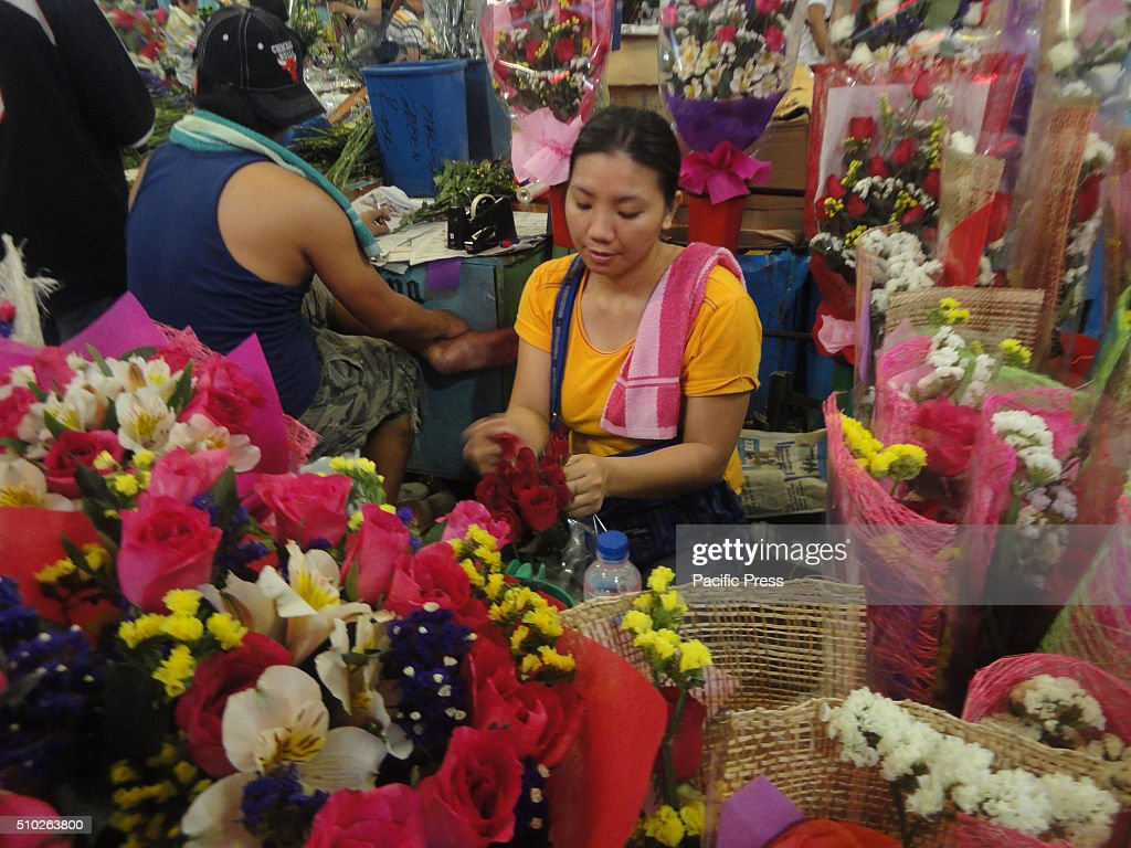 Filipino florist arranges flowers at the Dangwa flower market in Manila, Philippines on Valentine's Day. Valentines Day is celebrated on February 14 every year.