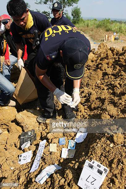 Filipino forensic experts recover documents as they resume digging bodies and evidence at the massacre site in the southern Philippine town of...