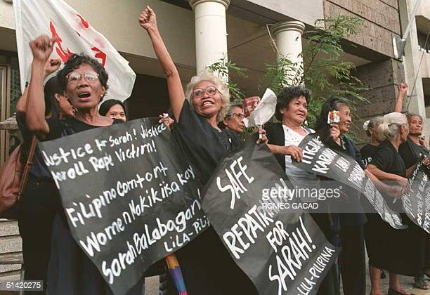Filipino former 'comfort women' at the hands of Japanese soldiers during World War II react outside the United Arab Emirates consulate in Manila 30...
